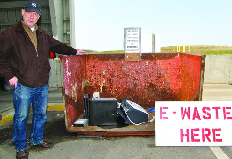 Southold Town solid waste coordinator Jim Bunchuck at the new free e-waste disposal area at the Cutchogue transfer station. Over the weekend the container had to be emptied twice each day as residents filled it with their old electronic equipment.