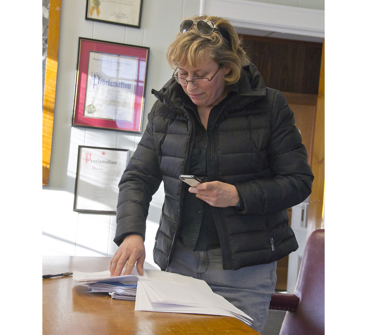 Candidate for Greenport Mayor Zuleyha Lillis inspects her opponent George Hubbard's petitions. (Credit: Paul Squire)