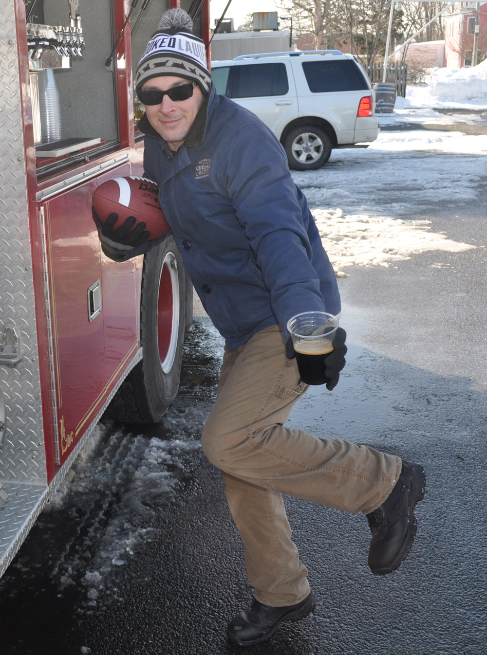 Nate Payne of Crooked Ladder Brewing Company strikes the Heisman pose ... or something like it.