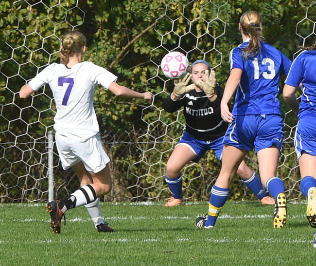 Mattituck goalkeeper Emma Fasolino makes a save on Port Jefferson forward Jillian Colucci, who leads the county in goals scored this year. (Credit: Robert O'Rourk)