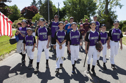 Little League teams marched in Peconic Saturday morning. (Credit: Katharine Schroeder)