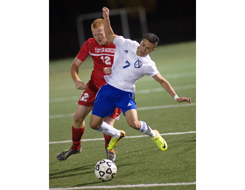 GARRET MEADE PHOTO   Mattituck's Mario Arreola appeared to lose his balance while being pressured by Center Moriches' Mike Colombi.