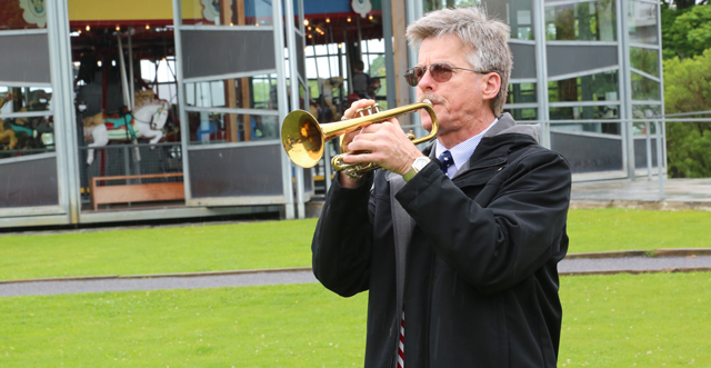 Colin Van Tuyl plays 'Taps' in Mitchell Park. (Credit: Grant Parpan)