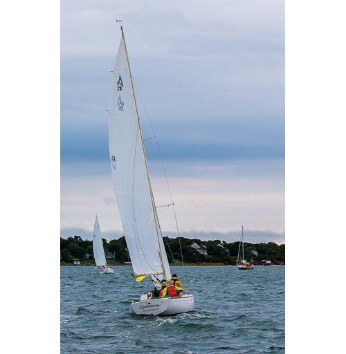 The sailboat Optimistic sails in Cutchogue Harbor before last weekend's Whitebread race. The boat would late sink off Shelter Island in rough seas. But the boat could soon sail again. (Credit: Richard Labella)