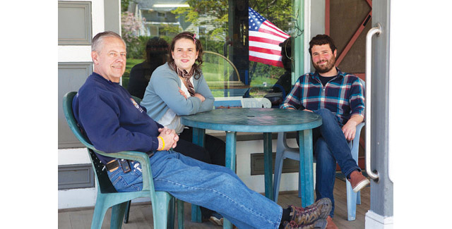 KATHARINE SCHROEDER PHOTO   Orient Country Store's former owner Linton Duell, left, with new owners Miriam Foster and Grayson Murphy on Thursday.