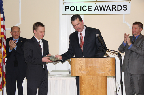 CARRIE MILLER PHOTO  |  Southold police officer Jacob Bogdoen receives an Officer of the Year award, which was presented by chief Martin Flatley.