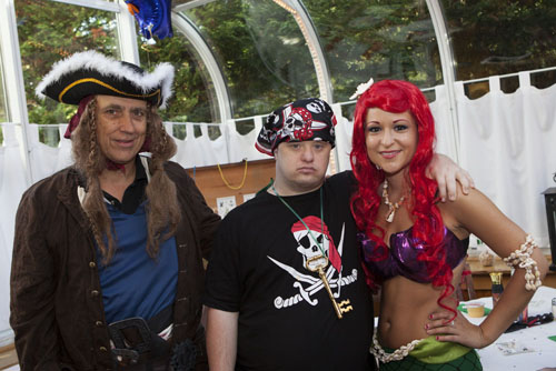 Pirate Warren Breuer, left, with guest of honor Paul Drum and mermaid Priscilla Kavanagh. (Credit: