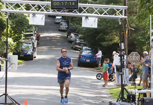 KATHARINE SCHROEDER PHOTO | Shawn Fitzgerald of Cutchogue was the first to reach the finish line in 17 minutes 15.01 seconds.