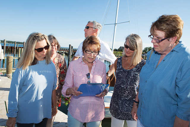 Carol Dinda, second from left, reads a passage in memory of Lilly Andrews. (Credit: Katharine Schroeder)