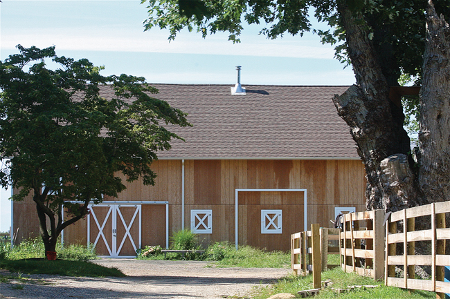 A stop-work order has been issued at the Showalter Farms property on Main Road in Mattituck, where this barn was resided and another pre-fab barn was delivered before the owners received building permits or site plan approval, town officials said.