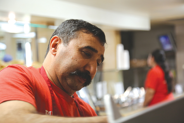 Harun 'Billy' Ilgin where you've probably seen him before, behind the counter at Wayside Market, where he always has a smile. (Credit: Krysten Massa photos)