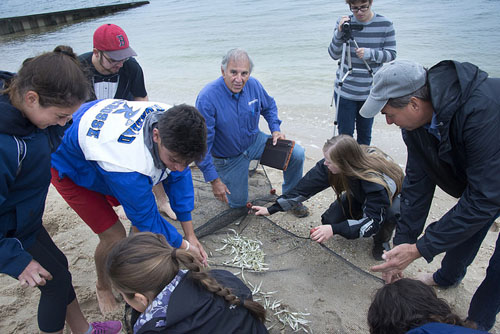 Mel Morris (center) works with students, educating them about the local environment. (Credit: Courtesy)