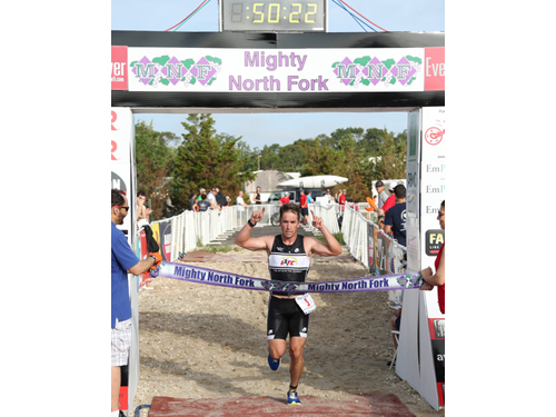 DANIEL DE MATO PHOTO | Shawn Fitzgerald of Cutchogue took the lead with about a half-mile to go and held it to the finish line for his first triathlon victory.