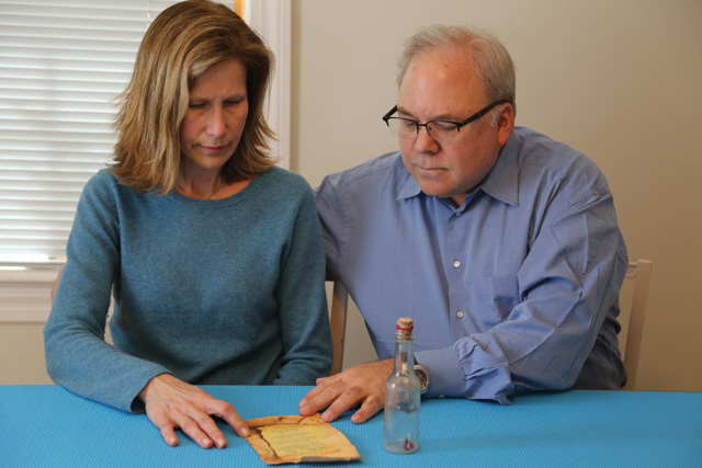 Heidi and Scott Vayer discovered the message in a bottle at Kenney's Beach in Southold. (Credit: Joe Werkmeister)