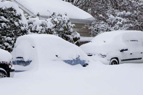 KATHARINE SCHROEDER PHOTO  |  Cars piled with snow in Cutchogue Saturday morning.
