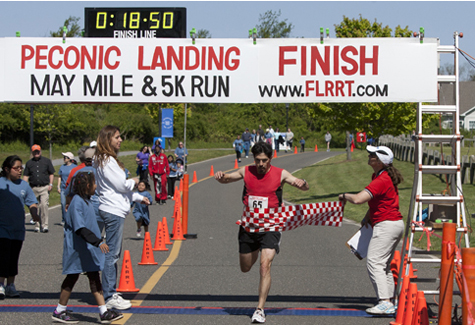 KATHARINE SCHROEDER PHOTO | Jack May of Main winning the May Mile 5K Saturday morning with a time of 18:50.